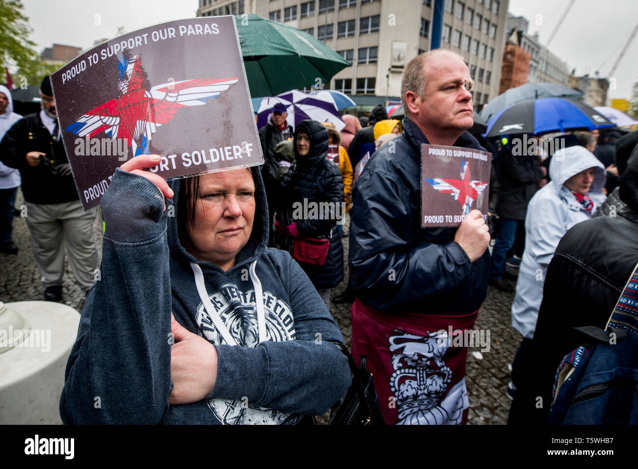 Protesters outside Belfast City Hall during a rally for soldier F, a former paratrooper who is due to stand trial for murder and attempted murder for his role in the 1972 Bloody Sunday killings. - Stock Image