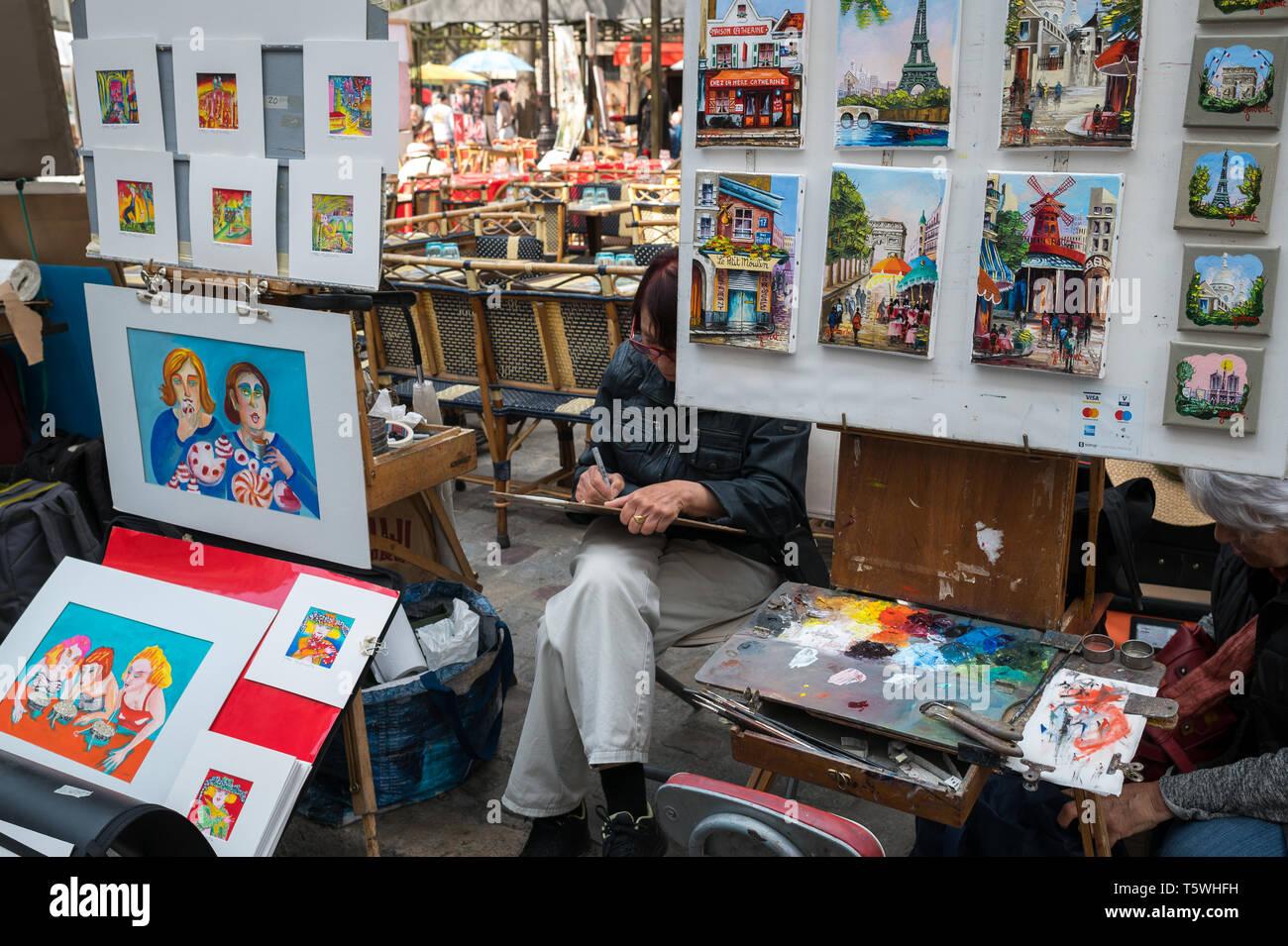 Montmartre, Paris, France - April 2019: Artists at work in Place du Tetre - Stock Image
