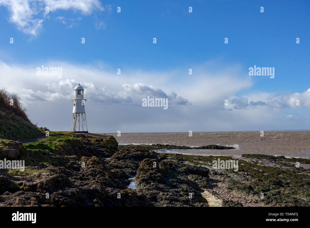 Black Nore lighthouse on the Bristol Channel at Portishead, somerset, UK. Now decommissioned the lighthouse is still a popular landmark for walkers. - Stock Image