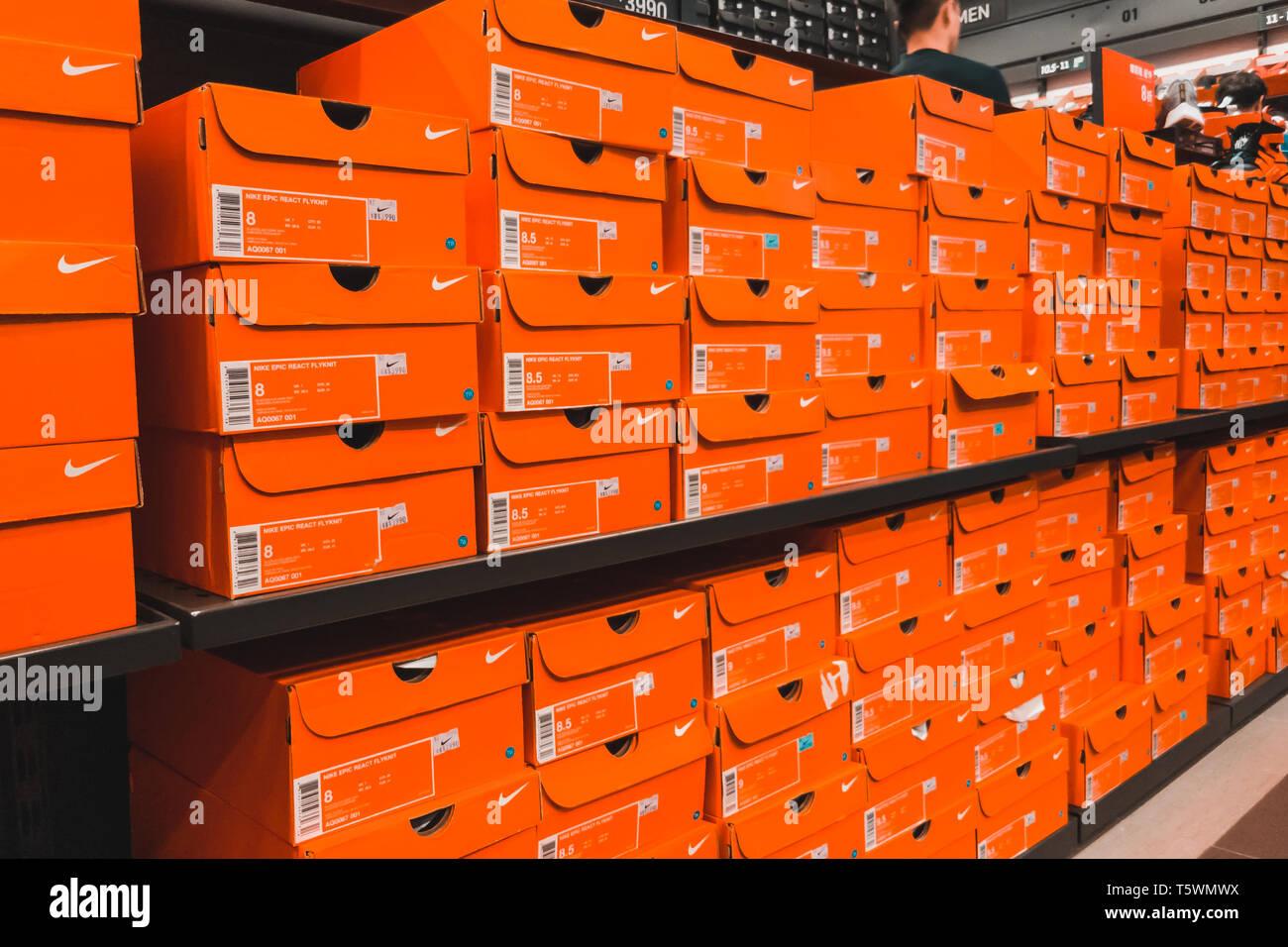 Huge stack of orange Nike Shoe boxes at