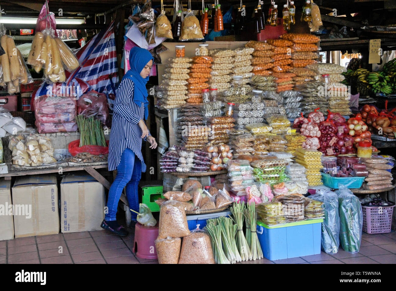 Muslim woman selling snacks and produce at Central Market, Kota Kinabalu, Sabah (Borneo), Malaysia - Stock Image