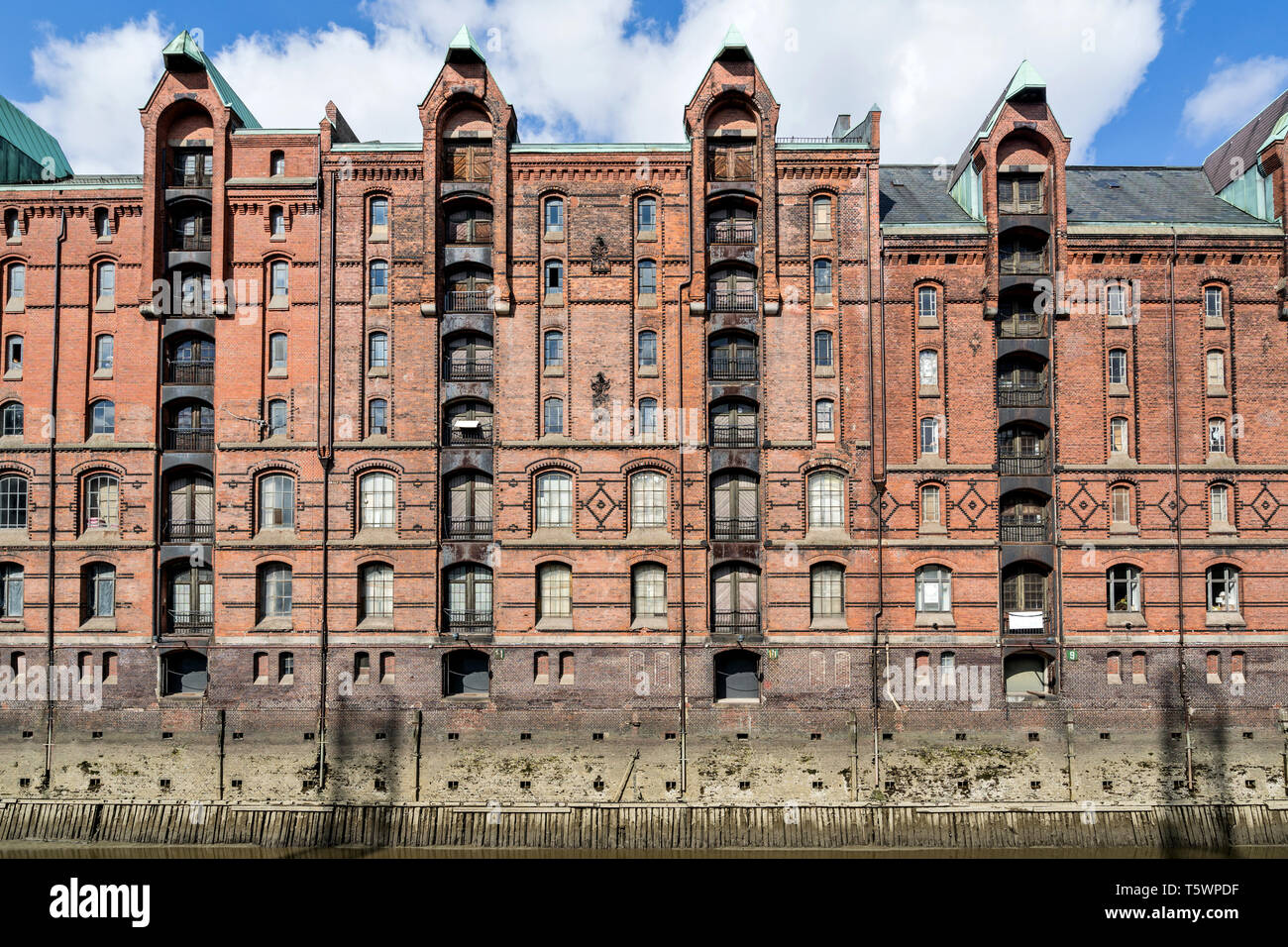Speicherstadt in Hamburg, Germany. It is the largest warehouse district in the world where the buildings stand on timber-pile foundations. Stock Photo