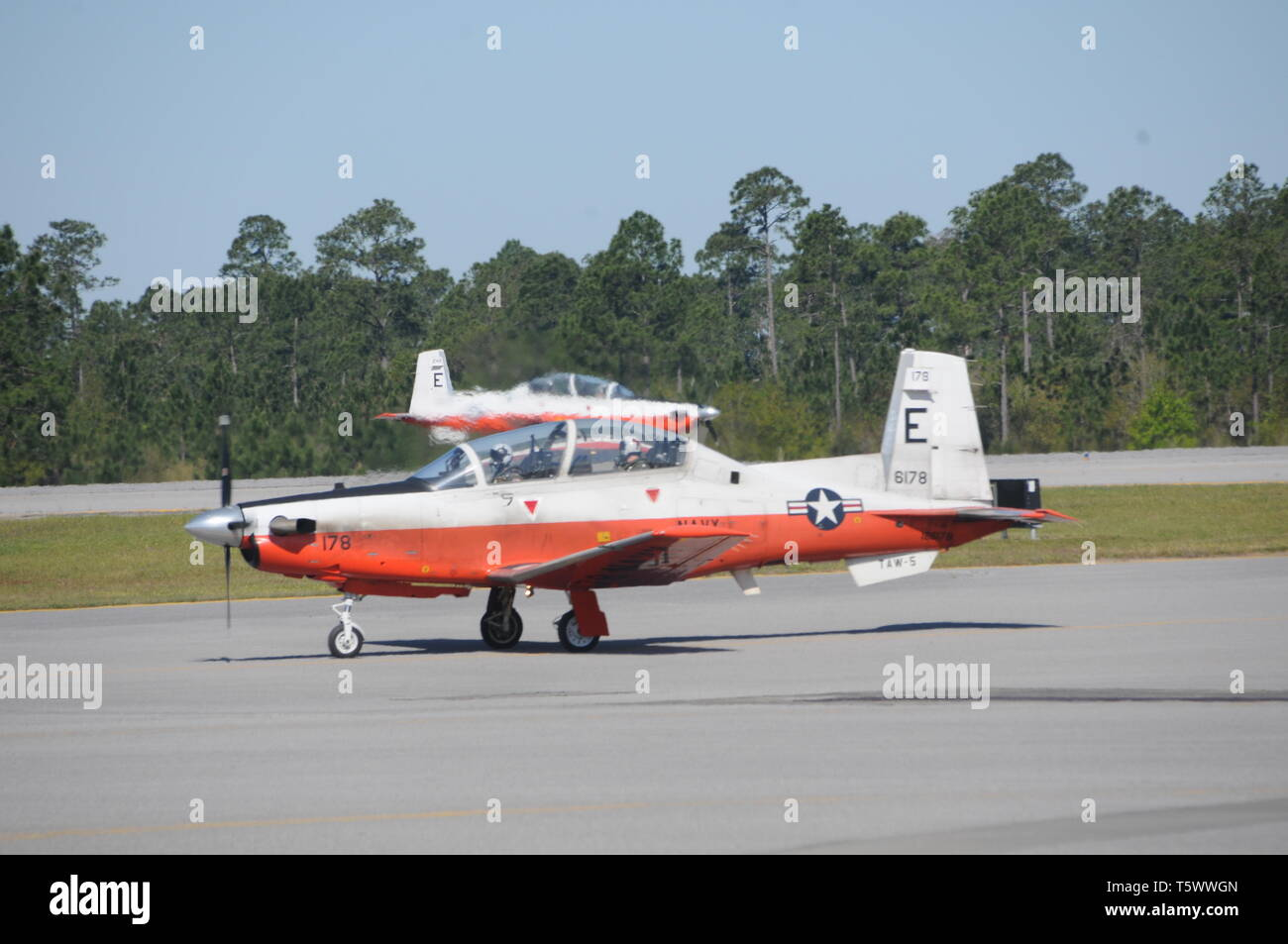 190401-N-OU681-1193 NAVAL AIR STATION WHITING FIELD, Fla. (April 1, 2019) -- Naval aviators from Training Squadron (VT) 2 taxi out for a training flight in two T-6B Texan II single-engine turboprop aircraft at Naval Air Station Whiting Field, Fla., April 1. VT-2 is the Navy's oldest primary training squadron and graduates approximately 250 student each year. (U.S. Navy photo by Lt. Michelle Tucker/Released) - Stock Image