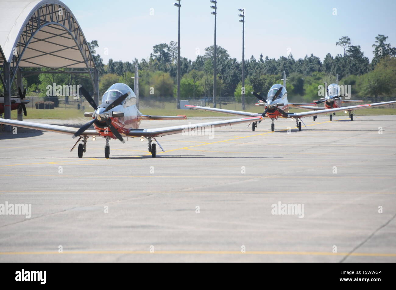 190401-N-OU681-1390 NAVAL AIR STATION WHITING FIELD, Fla. (April 1, 2019) -- Naval aviators from Training Squadron (VT) 2 taxi back after a training flight in T-6B Texan II single-engine turboprop aircraft at Naval Air Station Whiting Field, Fla., April 1. VT-2 is the Navy's oldest primary training squadron and graduates approximately 250 student each year.  (U.S. Navy photo by Lt. Michelle Tucker/Released) - Stock Image