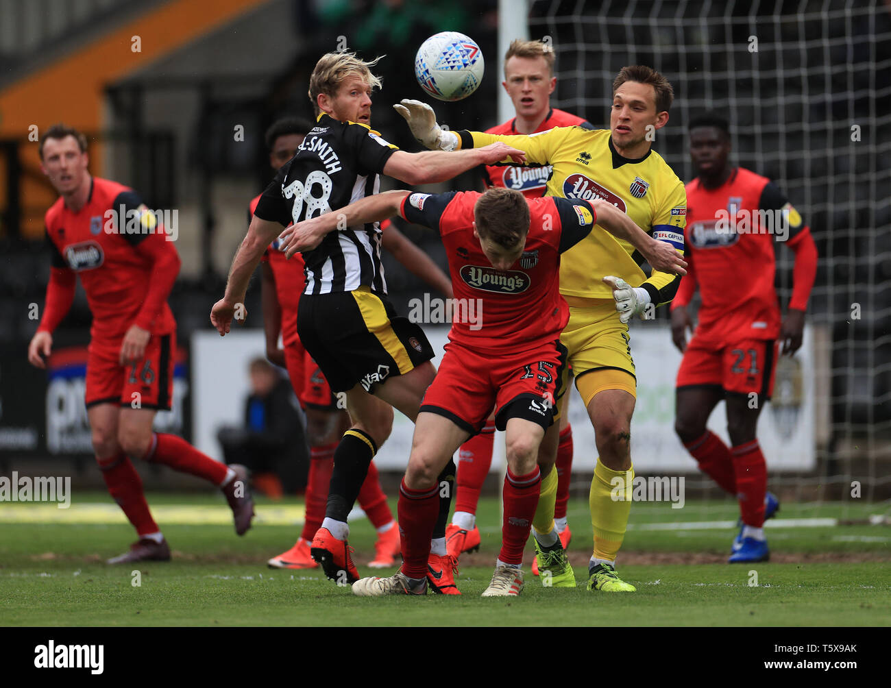 Notts County's Craig Mackail-Smith and Grimsby Town's James McKeown and Harry Clifton during the Sky Bet League Two match at Meadow Lane, Nottingham. - Stock Image