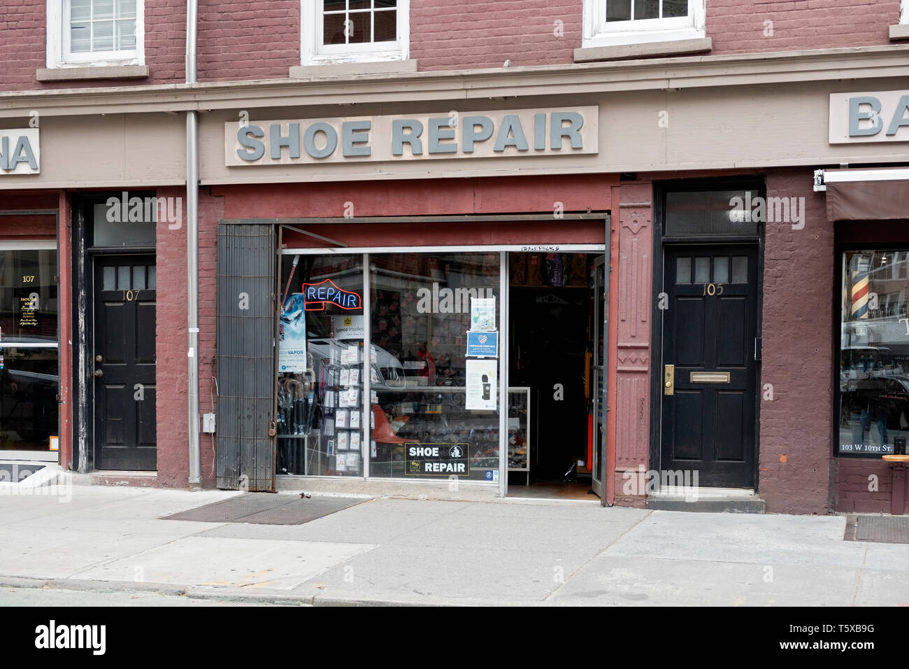 The exterior of a SHOE REPAIR store on West 10th Street in the West Village, downtown Manhattan, New York City. Stock Photo
