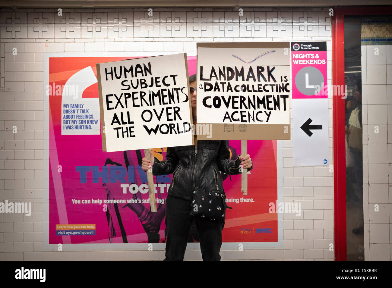A woman in the Union Street subway station protesting against data collection and privacy invasion. - Stock Image