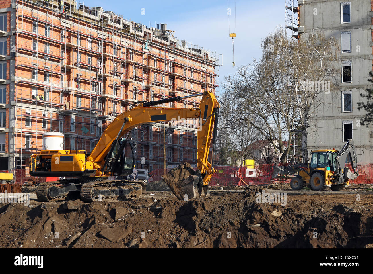 new building construction site and excavators - Stock Image