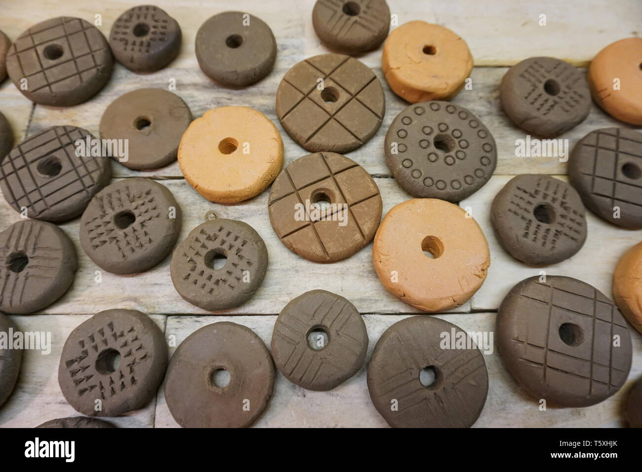 viking pottery spindle whorls in various designs based on the finds from hedeby haithabu - Stock Image
