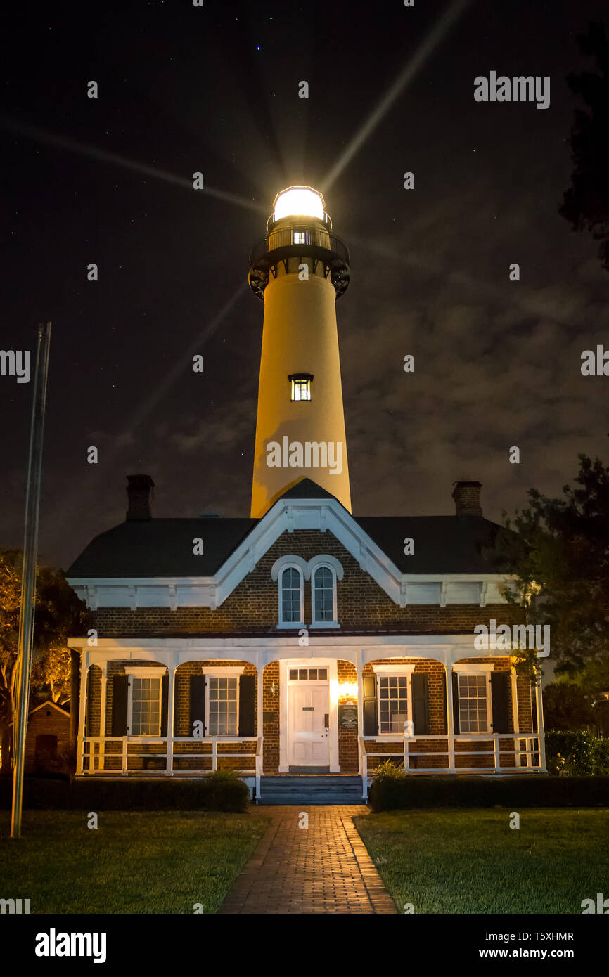 Beams of light project from St. Simons Lighthouse on St. Simons Island in Georgia. - Stock Image
