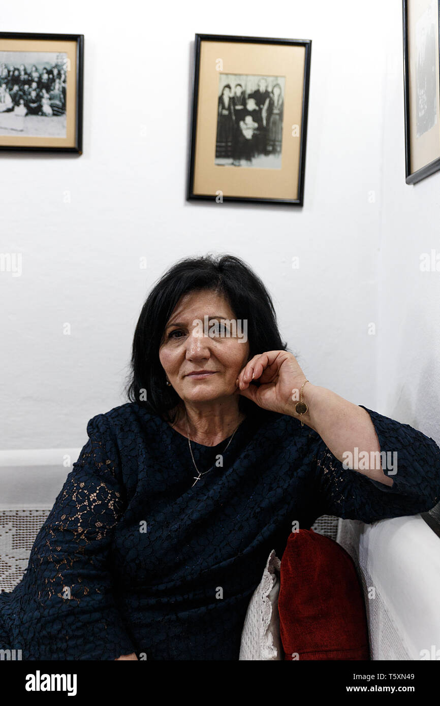 Tirana, Albania-April 13,2019: Owner of a typical Albanian restaurant poses at her premises for a foreign client. - Stock Image