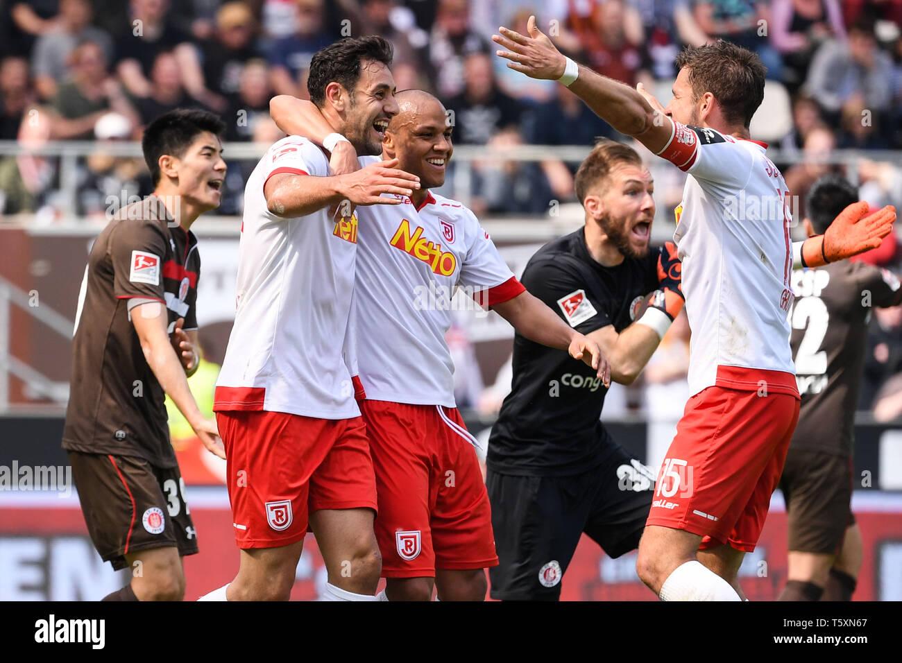 HAMBURG, GERMANY - APRIL 27: Hamadi Al Ghaddioui (L) of SSV Jahn Regensburg celebrates after scoring his team's first goal during the second Bundeslig - Stock Image