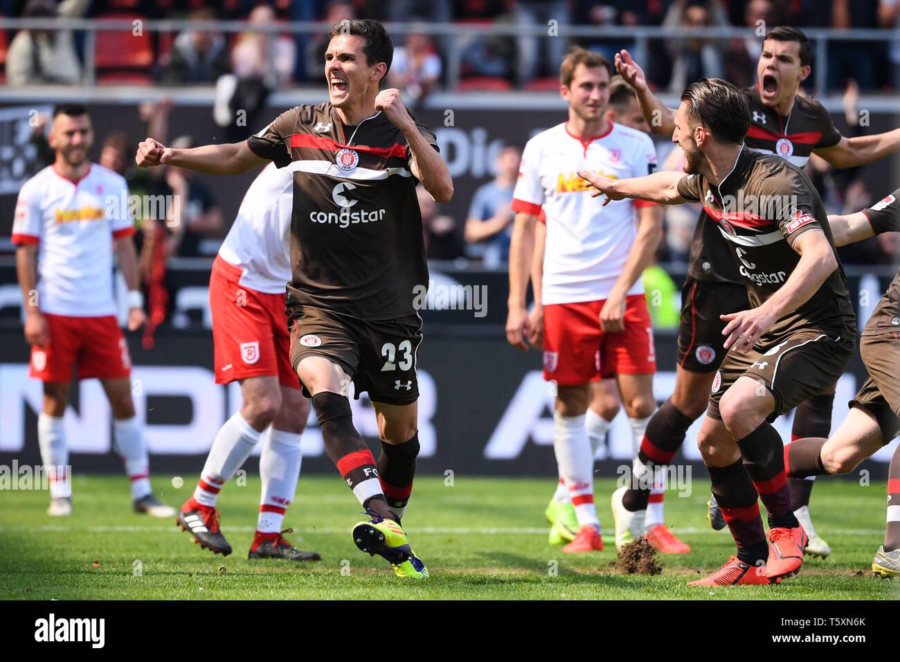 HAMBURG, GERMANY - APRIL 27: Johannes Flum (L) of FC Sankt Pauli celebrates after scoring his team's first goal during the second Bundesliga match bet - Stock Image