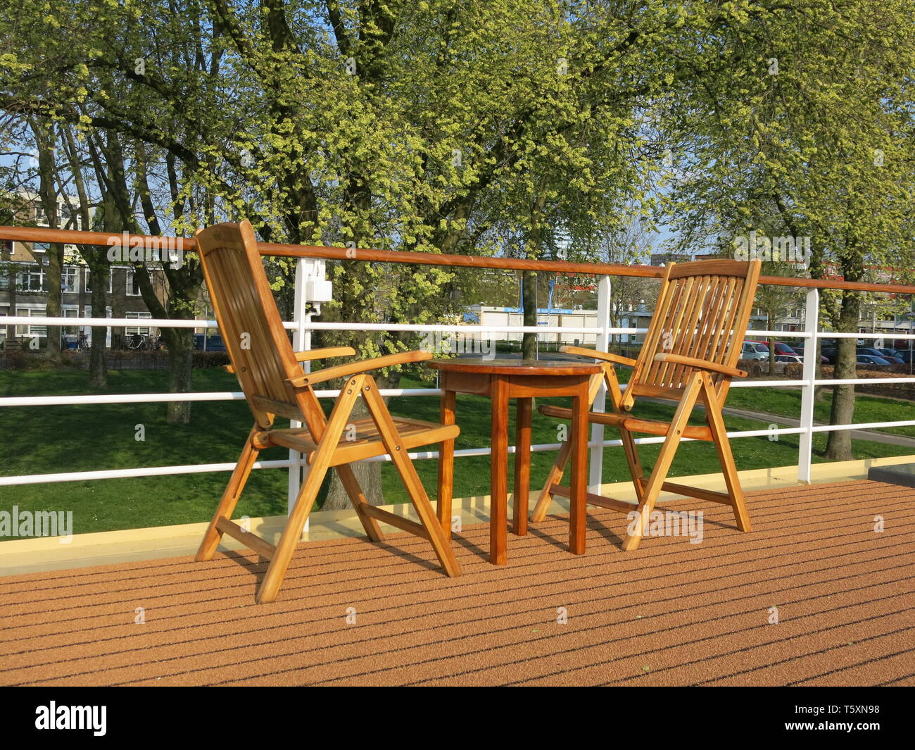 Table and chairs on deck the MS Royal Crown for passengers to admire the passing scenery whilst cruising the Dutch waterways - Stock Image