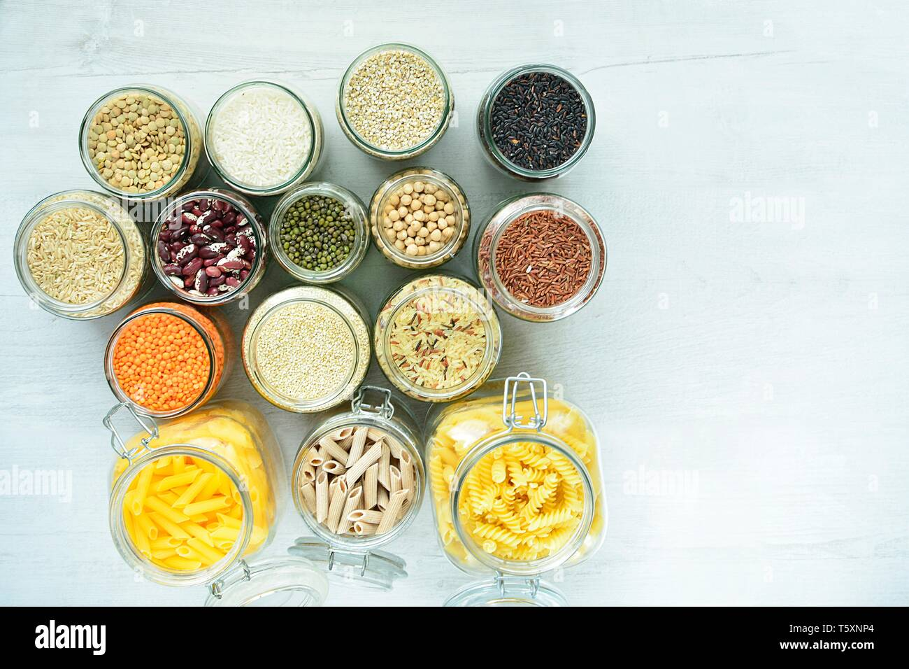 glass bins for storing legumes and pasta which are zero waste - Stock Image