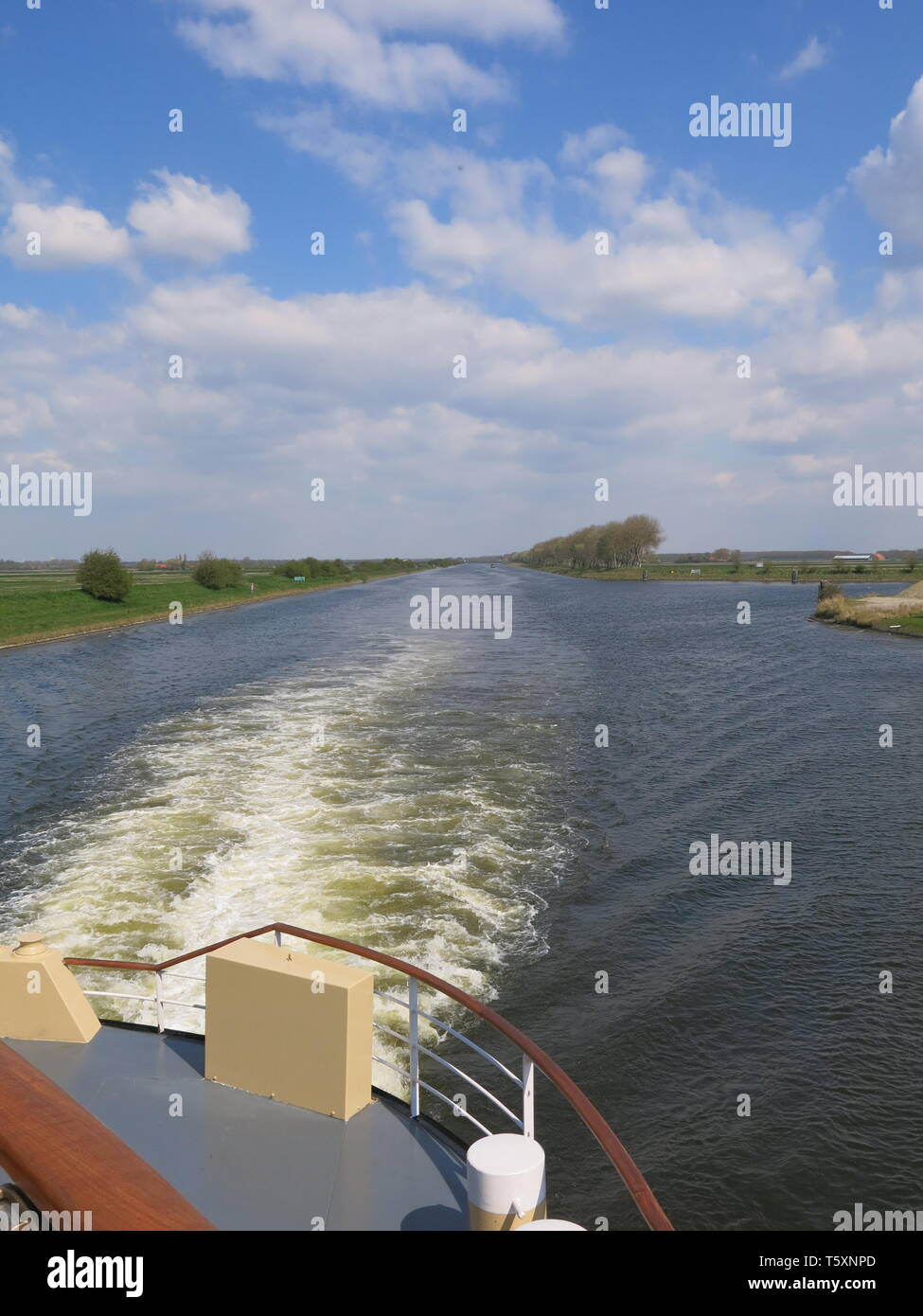 Cruising the waterways of the Netherlands is a peaceful way to explore the wide, flat canal and river landscape. - Stock Image