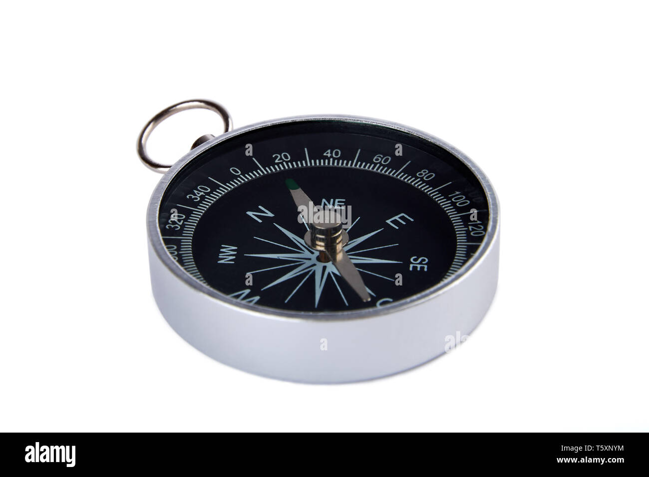Detailed view of a magnetic compass silver and black color, isolated on white background. - Stock Image