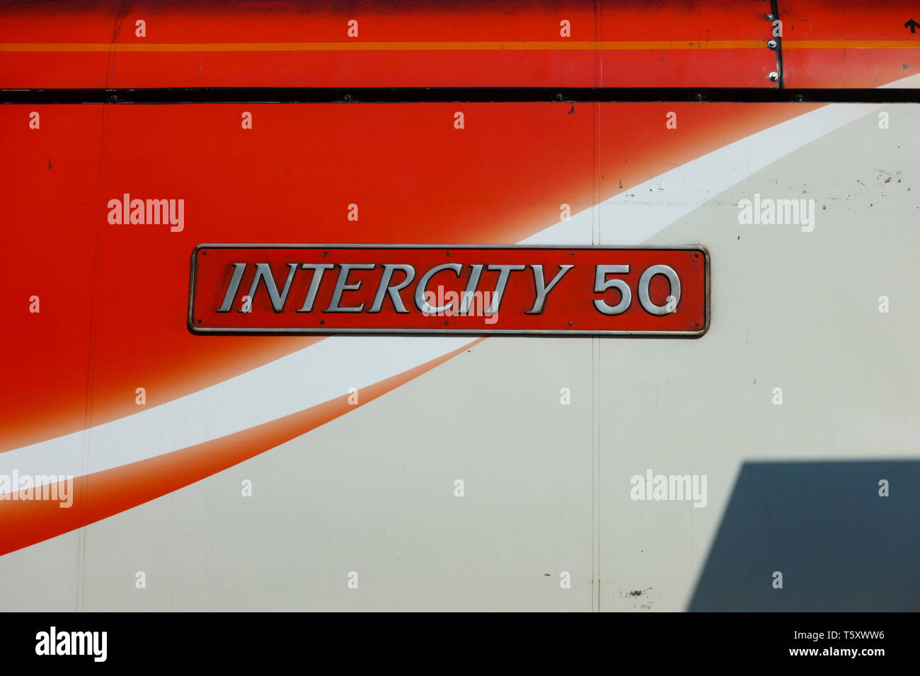 'Intercity 50' nameplate on the side of an electric railway engine of the London North Eastern line. - Stock Image