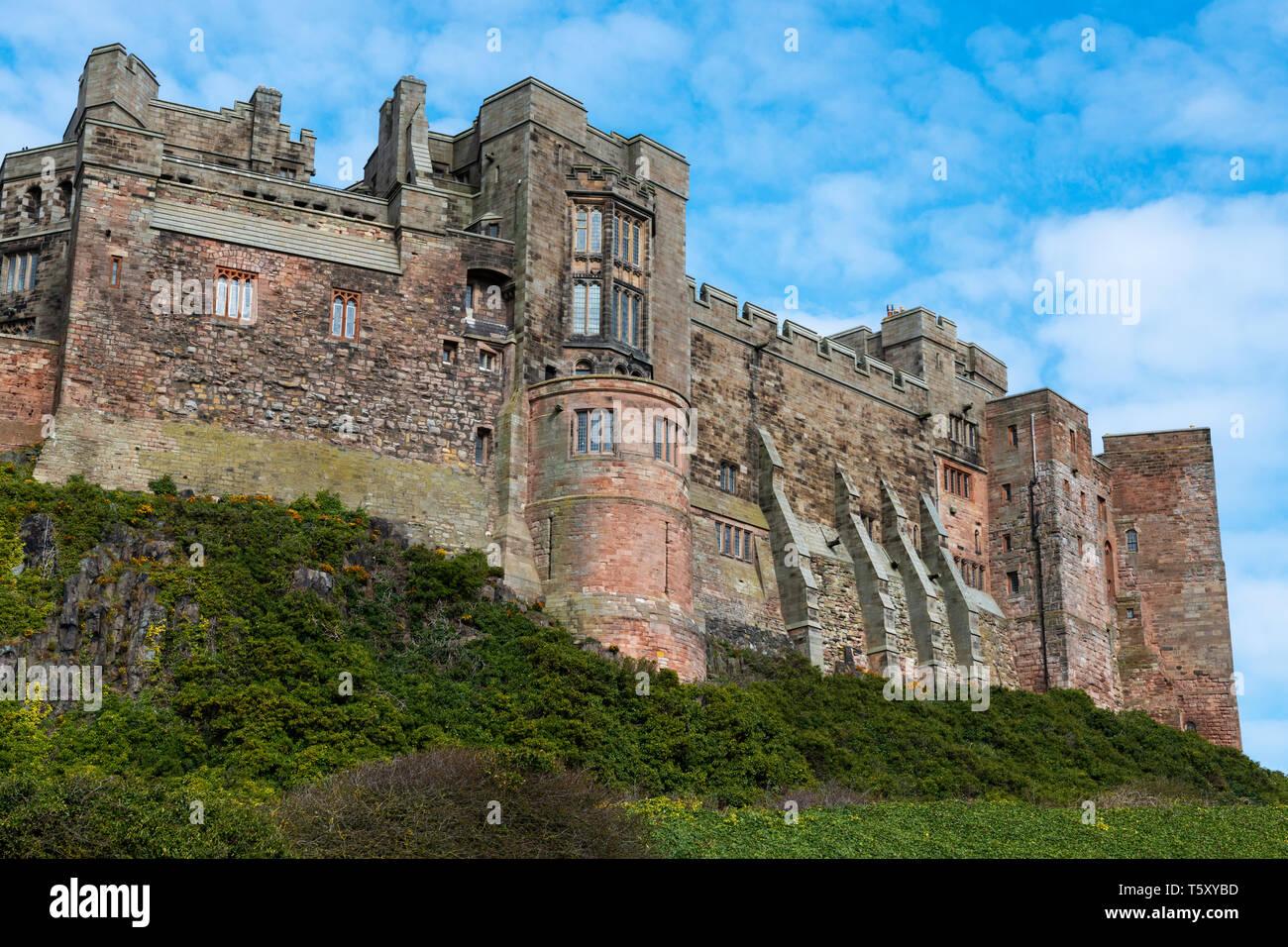 External view of Bamburgh Castle from Bamburgh Village, Northumberland, England, UK Stock Photo