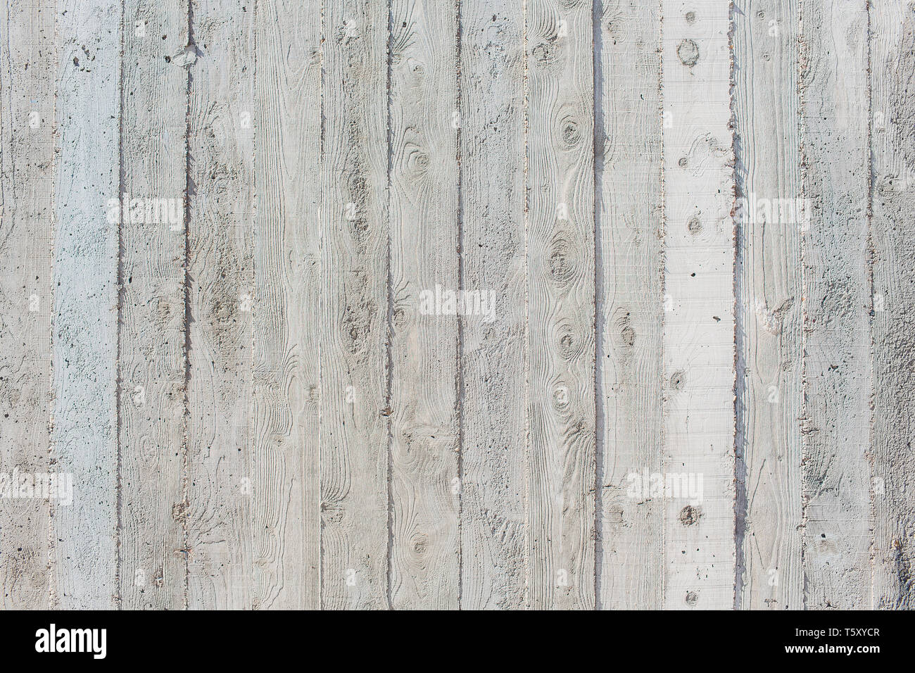 Concrete with a texture of wooden boards. Stock Photo