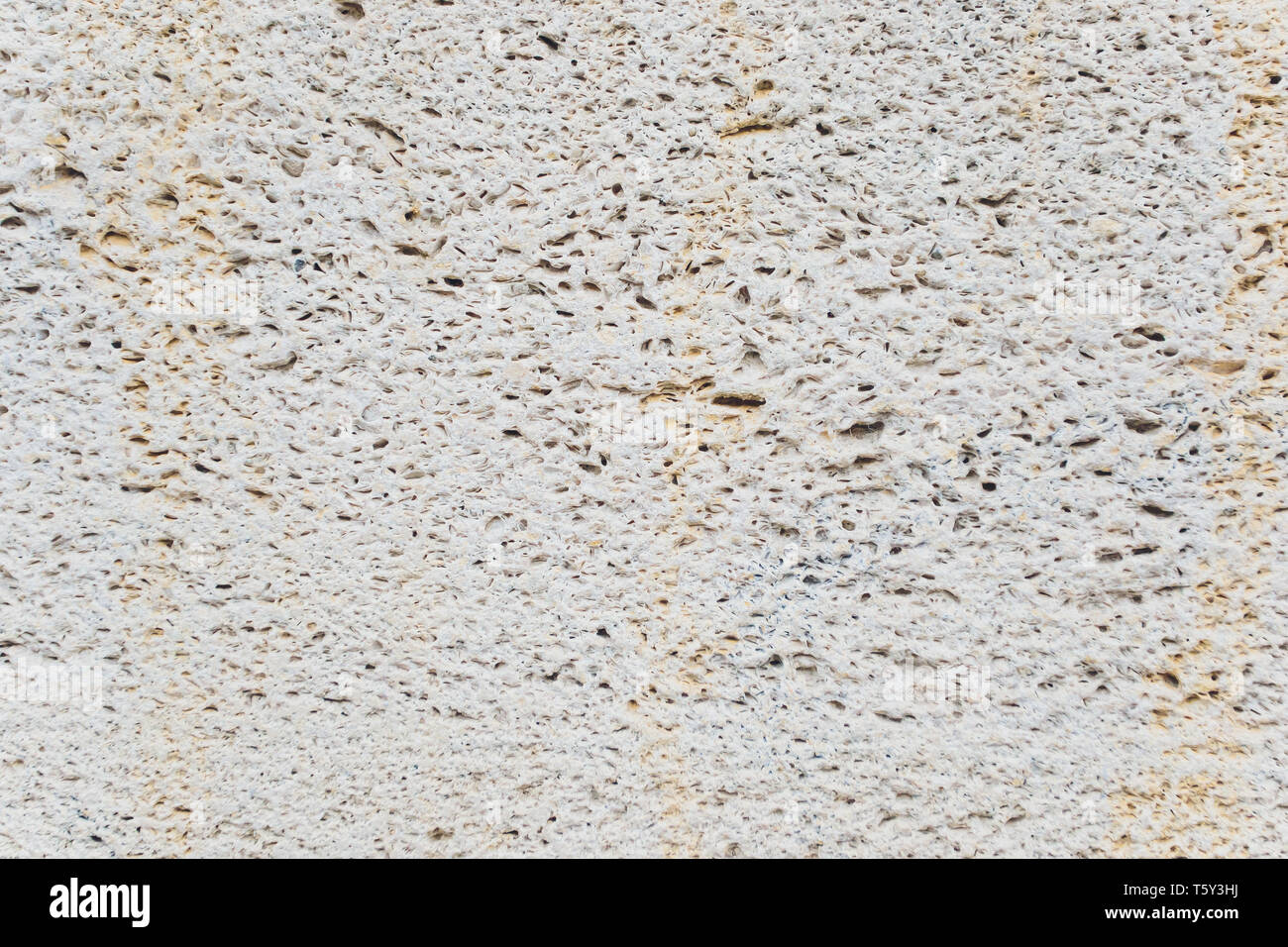 close up abstract industrial background and Cracked beautyful texture with deep pores of cement Smooth plastered stone Grey, Polished toned wall - Stock Image