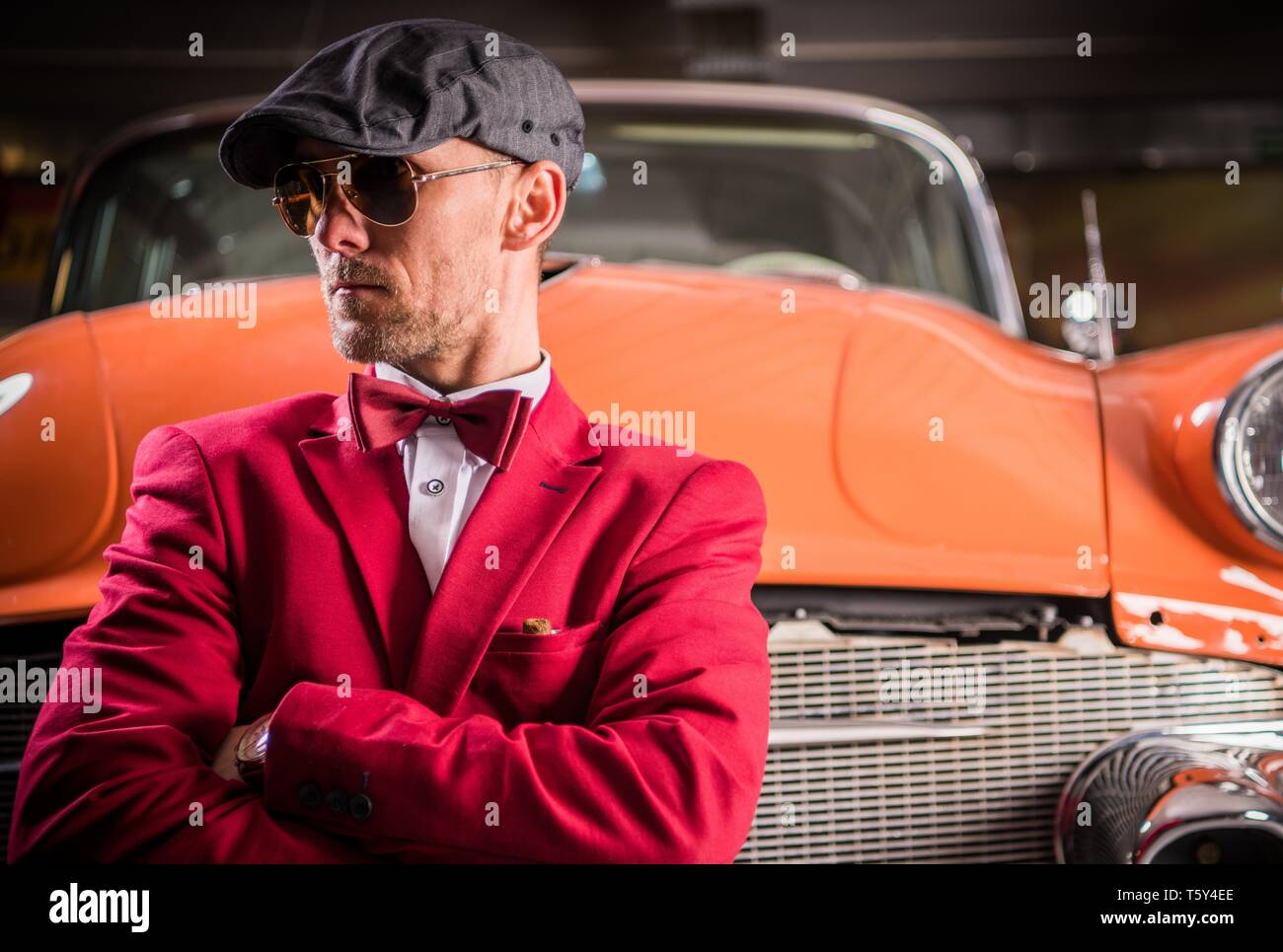 Young Oldtimers Collector. Caucasian Men in His 30s in Front of His Classic Car. Stock Photo