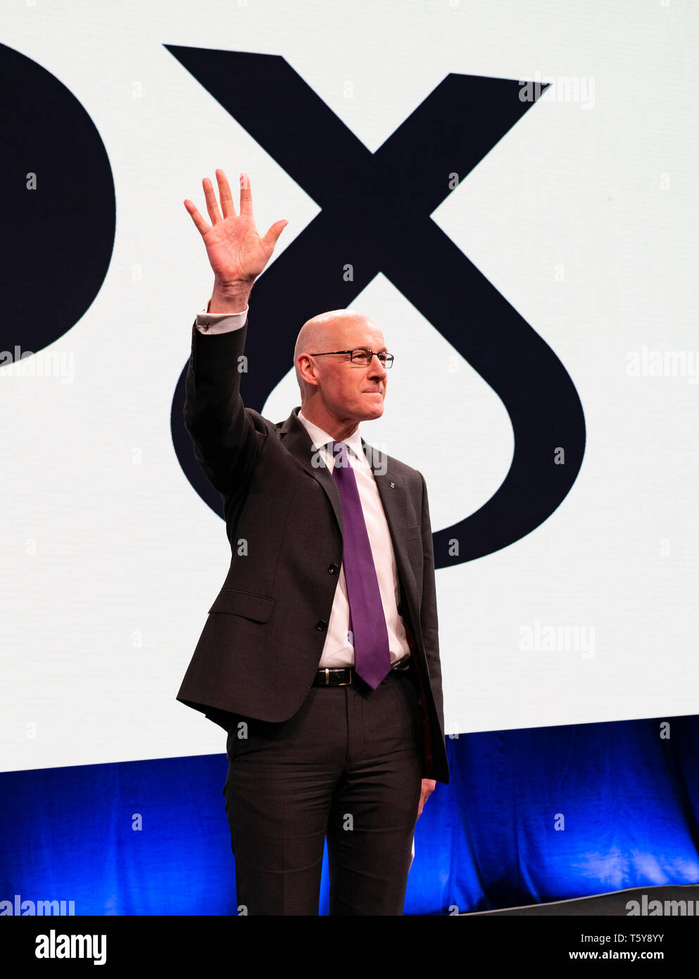 Edinburgh, Scotland, UK. 27 April, 2019. SNP ( Scottish National Party) Spring Conference takes place at the EICC ( Edinburgh International Conference Centre) in Edinburgh. Pictured; Deputy First Minister John Swinney acknowledges delegates' applause at end of his speech  to the conference Credit: Iain Masterton/Alamy Live News - Stock Image