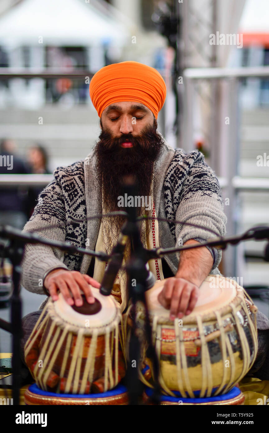 London, UK.  27 April 2019.  A performer on stage during the festival of Vaisakhi in Trafalgar Square, hosted by the Mayor of London.  For Sikhs and Punjabis, the festival celebrates the spring harvest and commemorates the founding of the Khalsa community over 300 years ago.  Credit: Stephen Chung / Alamy Live News - Stock Image