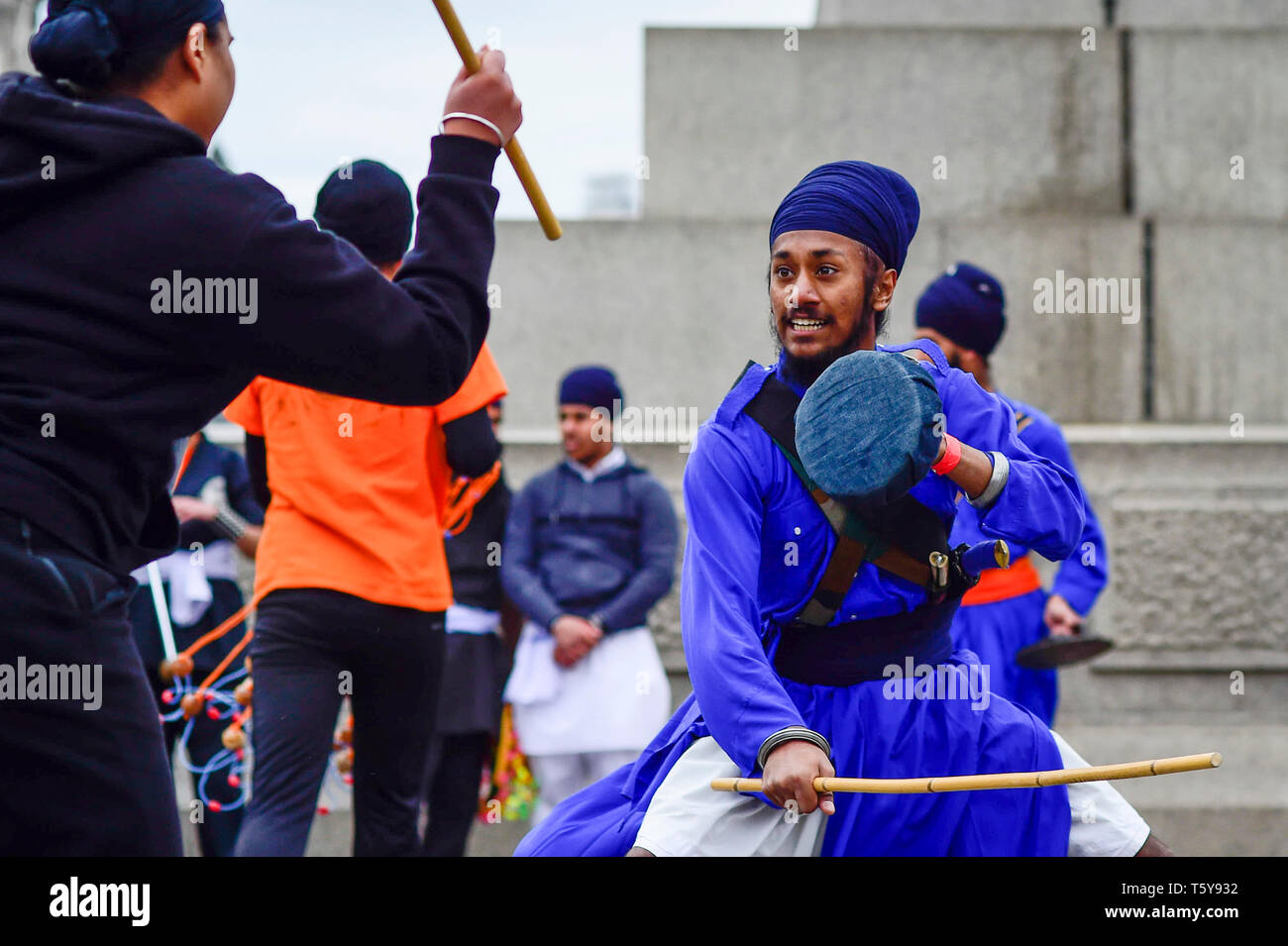 London, UK.  27 April 2019.  Men perform Gatka, Sikh martial arts, during the festival of Vaisakhi in Trafalgar Square, hosted by the Mayor of London.  For Sikhs and Punjabis, the festival celebrates the spring harvest and commemorates the founding of the Khalsa community over 300 years ago.   Credit: Stephen Chung / Alamy Live News - Stock Image