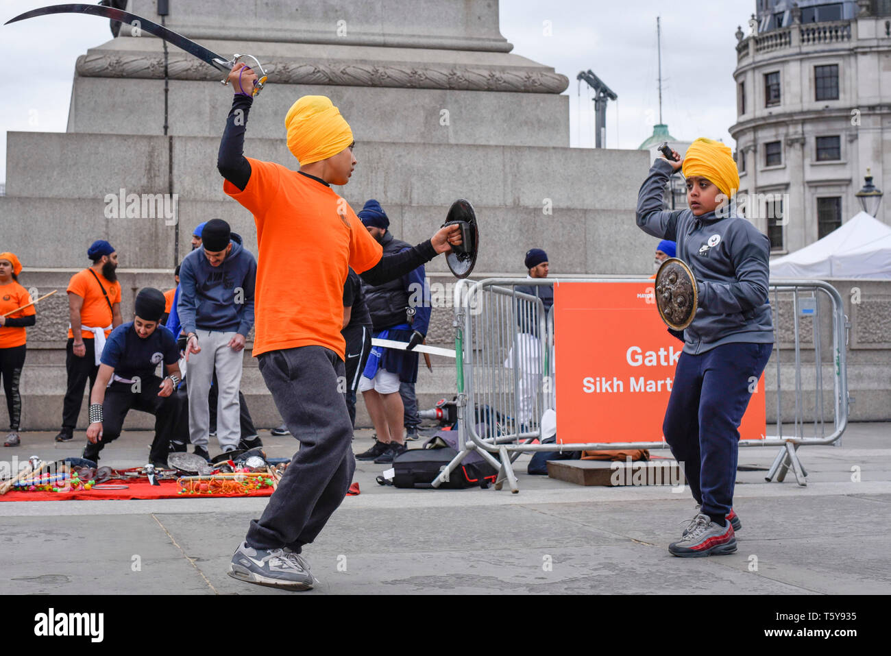 London, UK.  27 April 2019.  Young men perform Gatka, Sikh martial arts, during the festival of Vaisakhi in Trafalgar Square, hosted by the Mayor of London.  For Sikhs and Punjabis, the festival celebrates the spring harvest and commemorates the founding of the Khalsa community over 300 years ago.   Credit: Stephen Chung / Alamy Live News - Stock Image