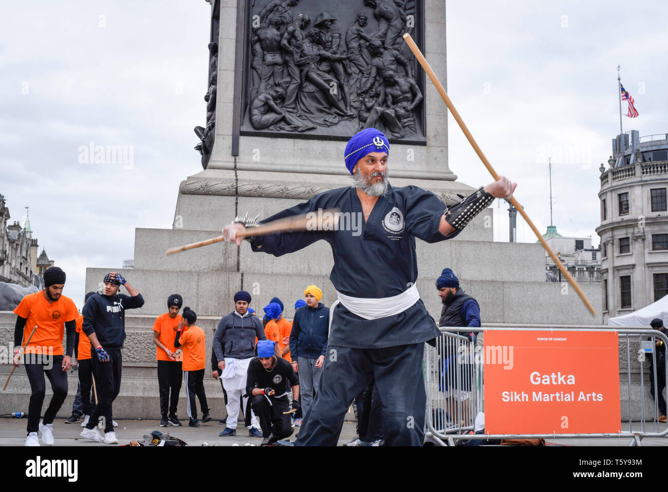 London, UK.  27 April 2019.  A man performs Gatka, Sikh martial arts, during the festival of Vaisakhi in Trafalgar Square, hosted by the Mayor of London.  For Sikhs and Punjabis, the festival celebrates the spring harvest and commemorates the founding of the Khalsa community over 300 years ago.   Credit: Stephen Chung / Alamy Live News - Stock Image