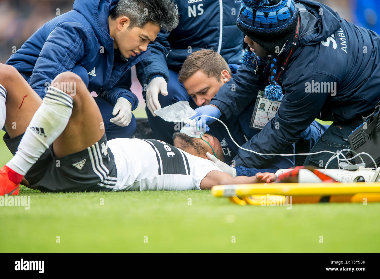 Craven Cottage, London, England, UK. 27th April 2019.  Denis Odoi of Fulham lies on the ground with blood on his face with an oxygen mask and receives medical attention during the Premier League match between Fulham and Cardiff City at Craven Cottage, London, England on 27 April 2019. Photo by Salvio Calabrese.  Editorial use only, license required for commercial use. No use in betting, games or a single club/league/player publications. - Stock Image