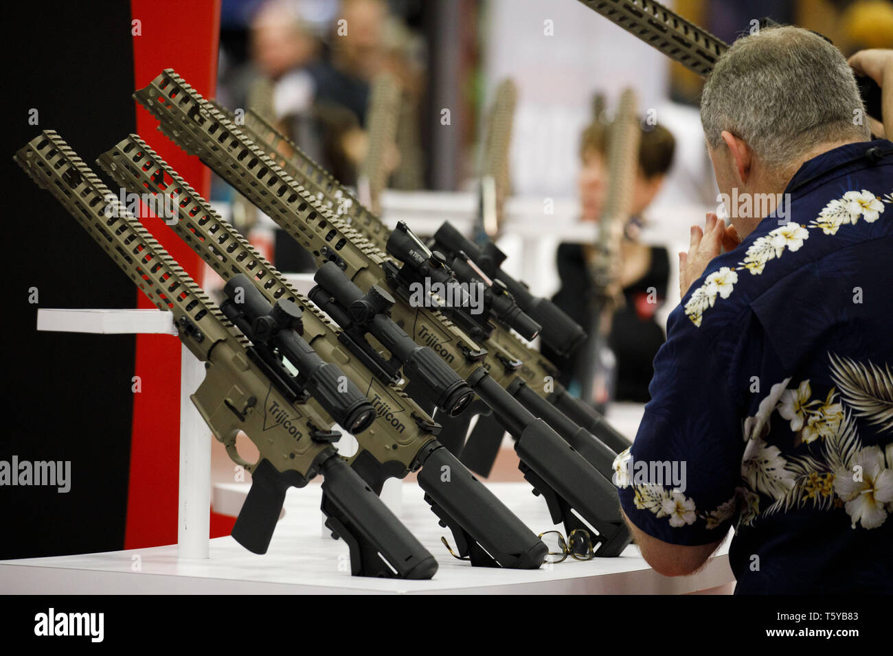 May 6, 2018 - Dallas, Texas, U.S. - An attendee looks at Trijicon sights for AR-15 style rifles during the National Rifle Association (NRA) annual meeting on Sunday, May 6, 2018 in Dallas, Texas.  © 2018 Patrick T. Fallon (Credit Image: © Patrick Fallon/ZUMA Wire) Stock Photo