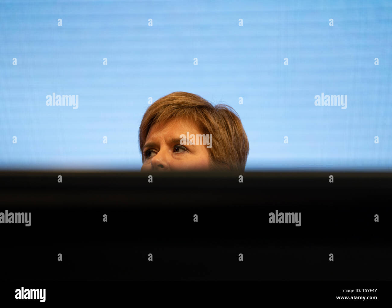 Edinburgh, Scotland, UK. 27 April, 2019. SNP ( Scottish National Party) Spring Conference takes place at the EICC ( Edinburgh International Conference Centre) in Edinburgh. Pictured; First Minister Nicola Sturgeon, partially hidden behind table Credit: Iain Masterton/Alamy Live News - Stock Image