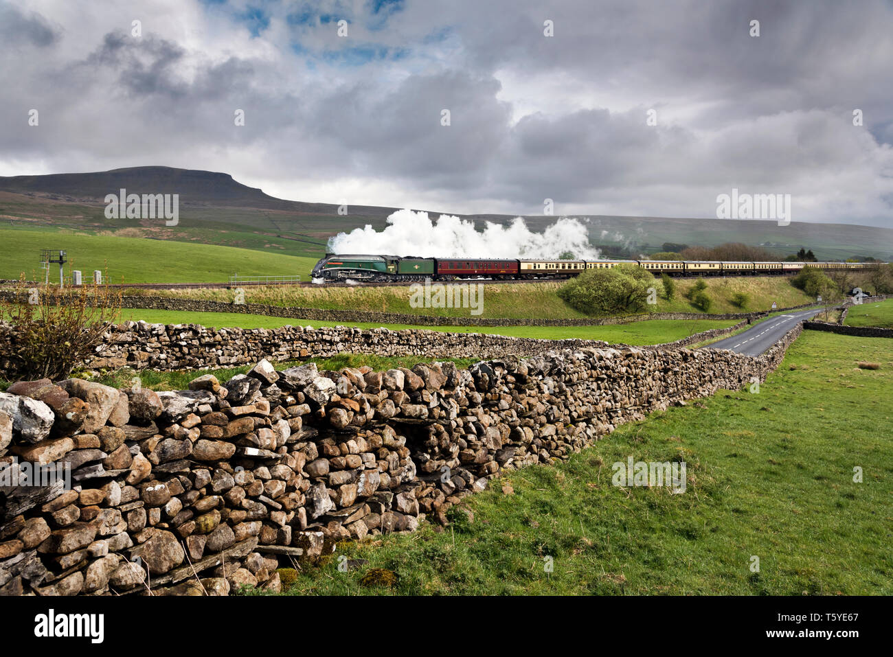 North Yorkshire, UK. 27th April 2019. A4 Class streamlined steam locomotive 'Union of South Africa' hauls a York to Carlisle special train on the Settle-Carlisle railway line, seen here at Horton-in-Ribblesdale in the Yorkshire Dales National Park. Credit: John Bentley/Alamy Live News - Stock Image