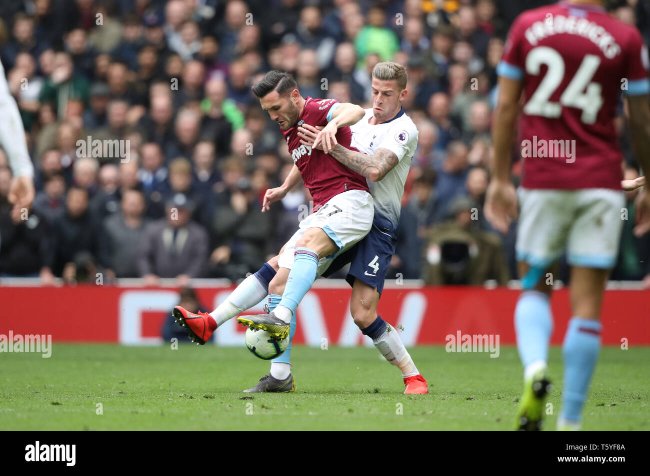 London, UK. 27th Apr 2019. Lucas Perez (WHU) Toby Alderweireld (TH) at the Tottenham Hotspur v West Ham United English Premier League match, at The Tottenham Hotspur Stadium, London, UK on April 27, 2019. **Editorial use only, license required for commercial use. No use in betting, games or a single club/league/player publications** Credit: Paul Marriott/Alamy Live News - Stock Image