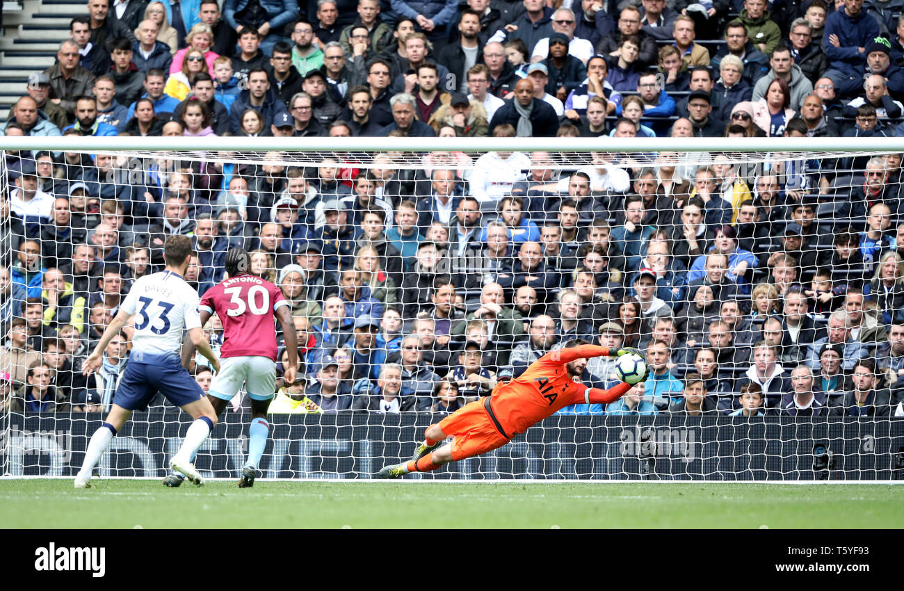 London, UK. 27th Apr 2019. Hugo Lloris (TH) makes a save at the Tottenham Hotspur v West Ham United English Premier League match, at The Tottenham Hotspur Stadium, London, UK on April 27, 2019. **Editorial use only, license required for commercial use. No use in betting, games or a single club/league/player publications** Credit: Paul Marriott/Alamy Live News - Stock Image