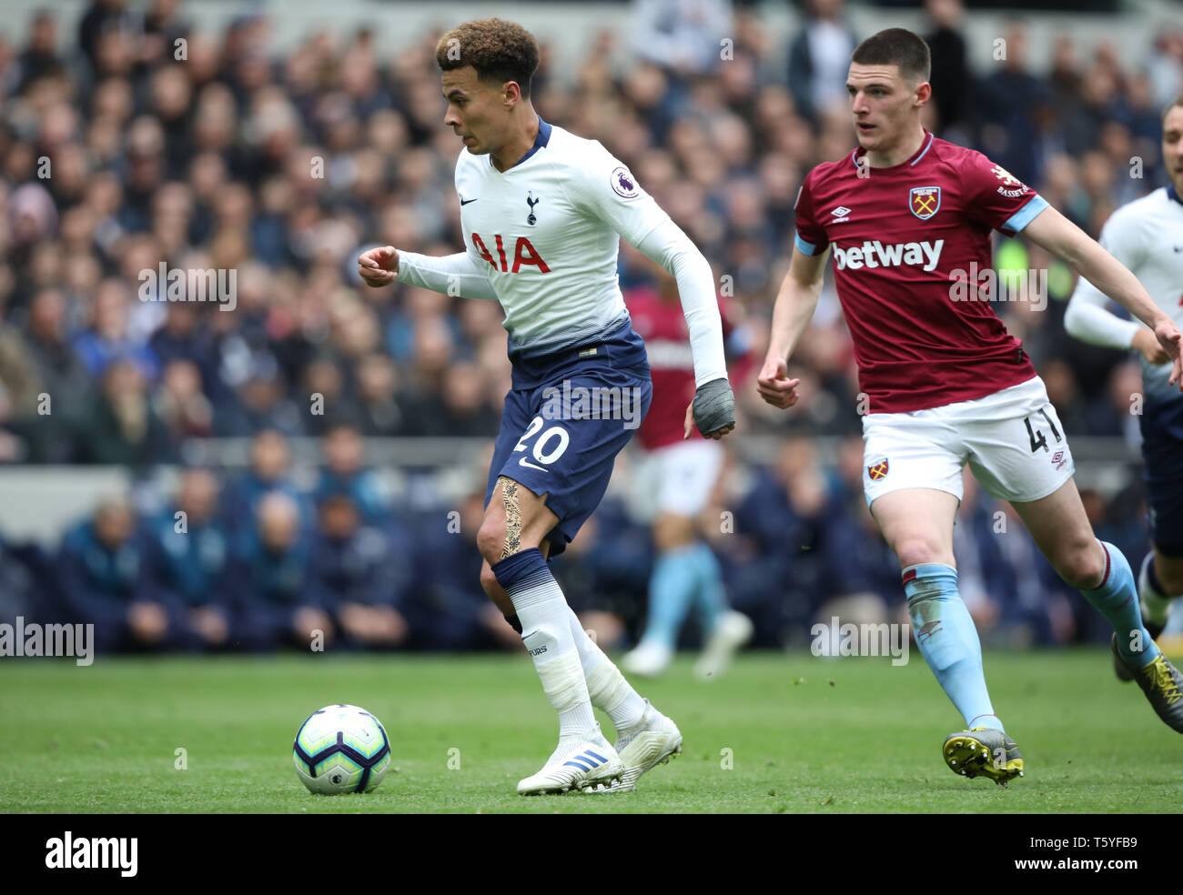 London, UK. 27th Apr 2019. Dele Alli (TH) Declan Rice (WHU) at the Tottenham Hotspur v West Ham United English Premier League match, at The Tottenham Hotspur Stadium, London, UK on April 27, 2019. **Editorial use only, license required for commercial use. No use in betting, games or a single club/league/player publications** Credit: Paul Marriott/Alamy Live News - Stock Image
