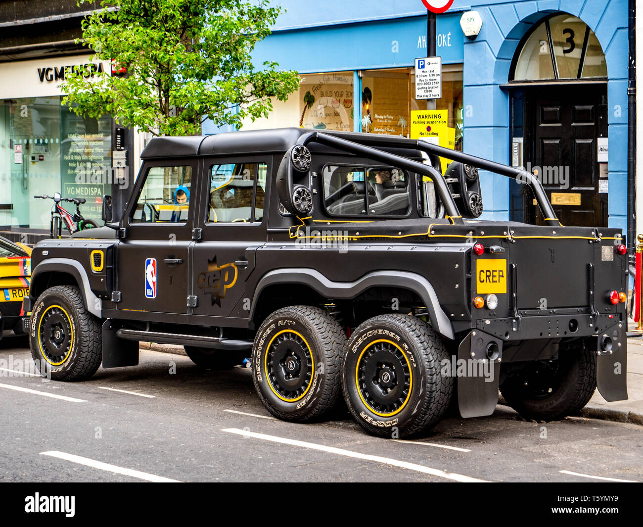 Six Wheel Drive Land Rover - the Crep Flying Huntsman 6x6 Pickup built by the Chelsea Truck Company for the Crep Cleaning Company London - Stock Image