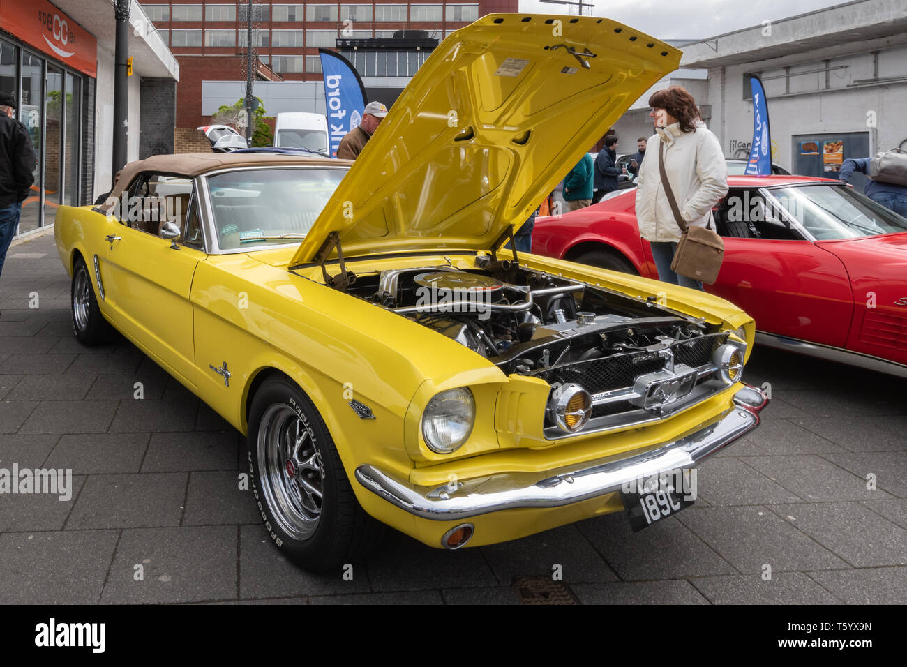 Yellow 1965 ford mustang 4700cc car at a classic motor vehicle show in the uk