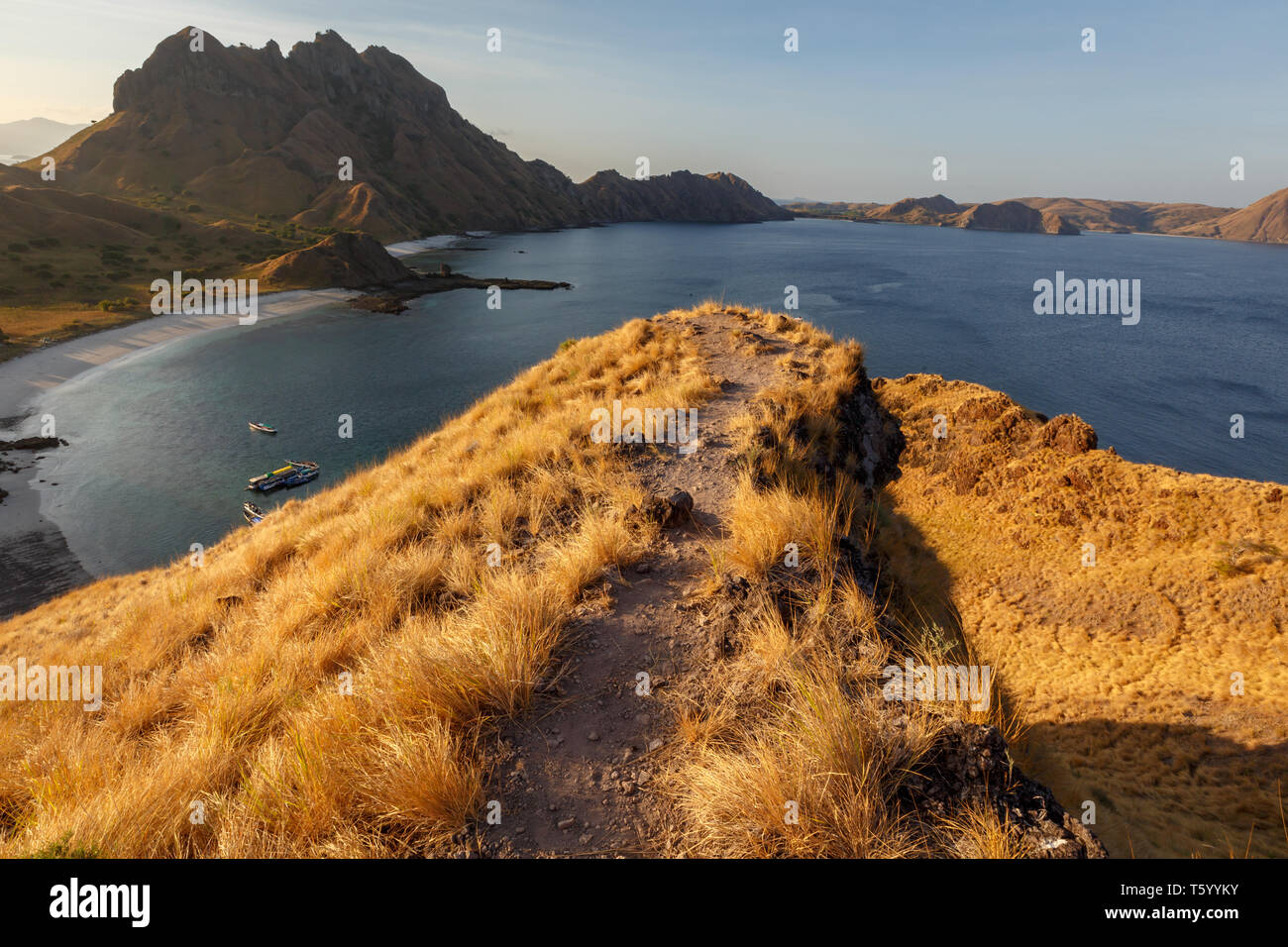 Sunset from hilltop on mountains in Komodo national park - Stock Image