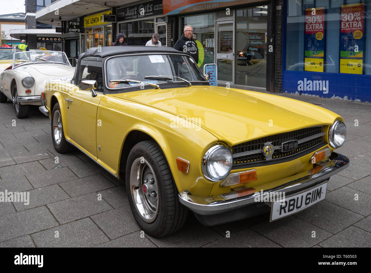Yellow 1973 Triumph TR6 car at a classic motor vehicle show in the UK - Stock Image