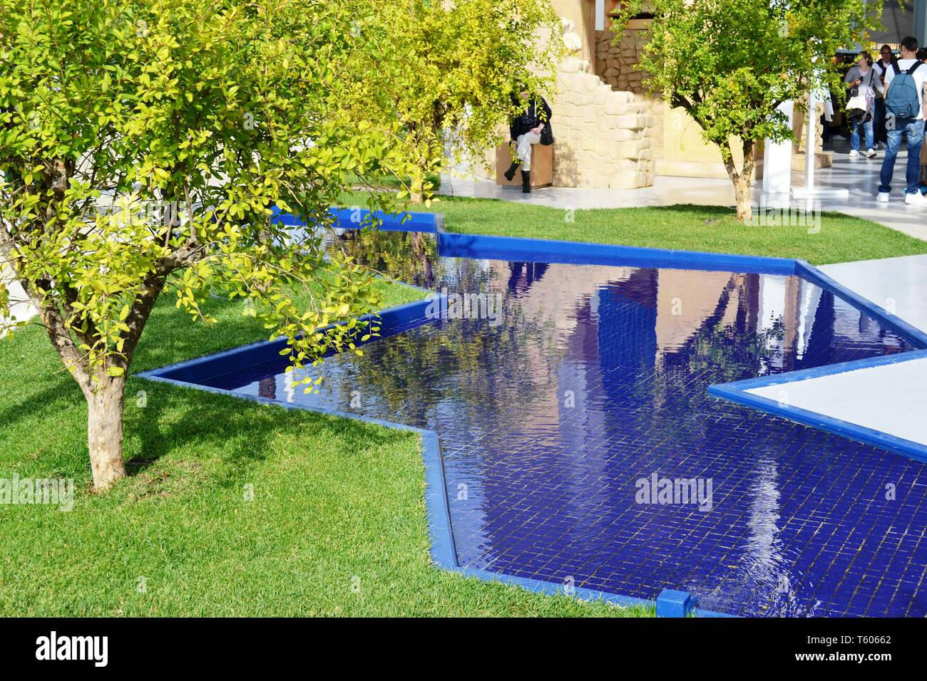 Milan/Italy - October 5, 2015: Close-up view to a beautiful blue pool in the garden of the Turkey EXPO Milano 2015 pavilion with ceramic tiles bottom, - Stock Image