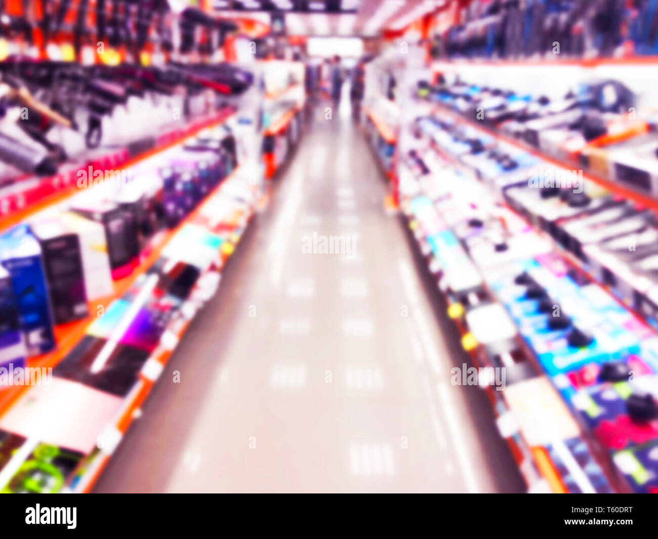 Abstract blur background with mobile store boutique in shopping mall. Eletronic department store interior with bokeh light blurred background. Defocus Stock Photo
