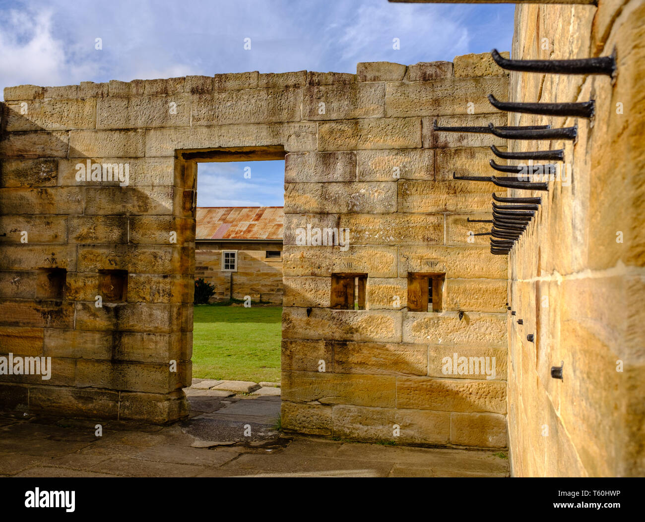 Cockatoo island Sydney, Australia, Historical stone prison building built by convicts for solitary confinement of prisoners in 1800s - Stock Image