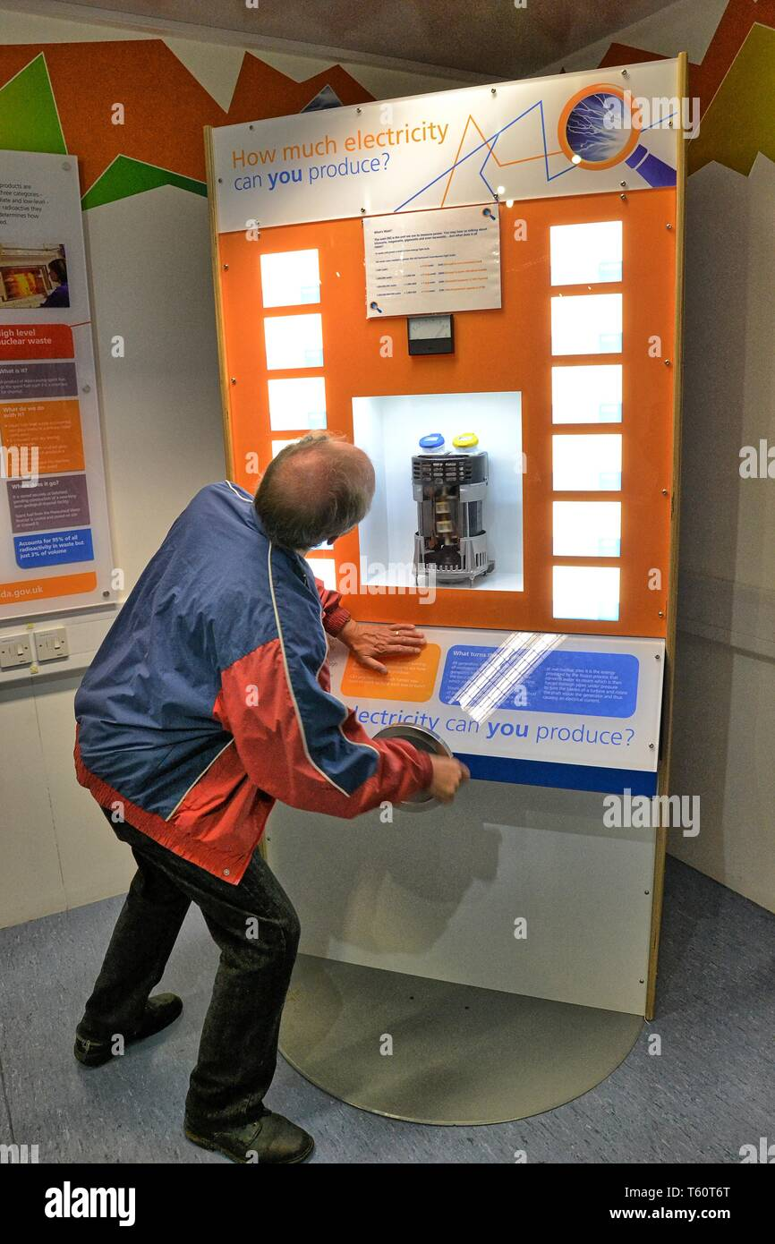Man testing how much electricity he can produce. Visitor Centre, inside the EDF Nuclear Power Station at Sizewell, Suffolk, UK. Nuclear Power Plant - Stock Image