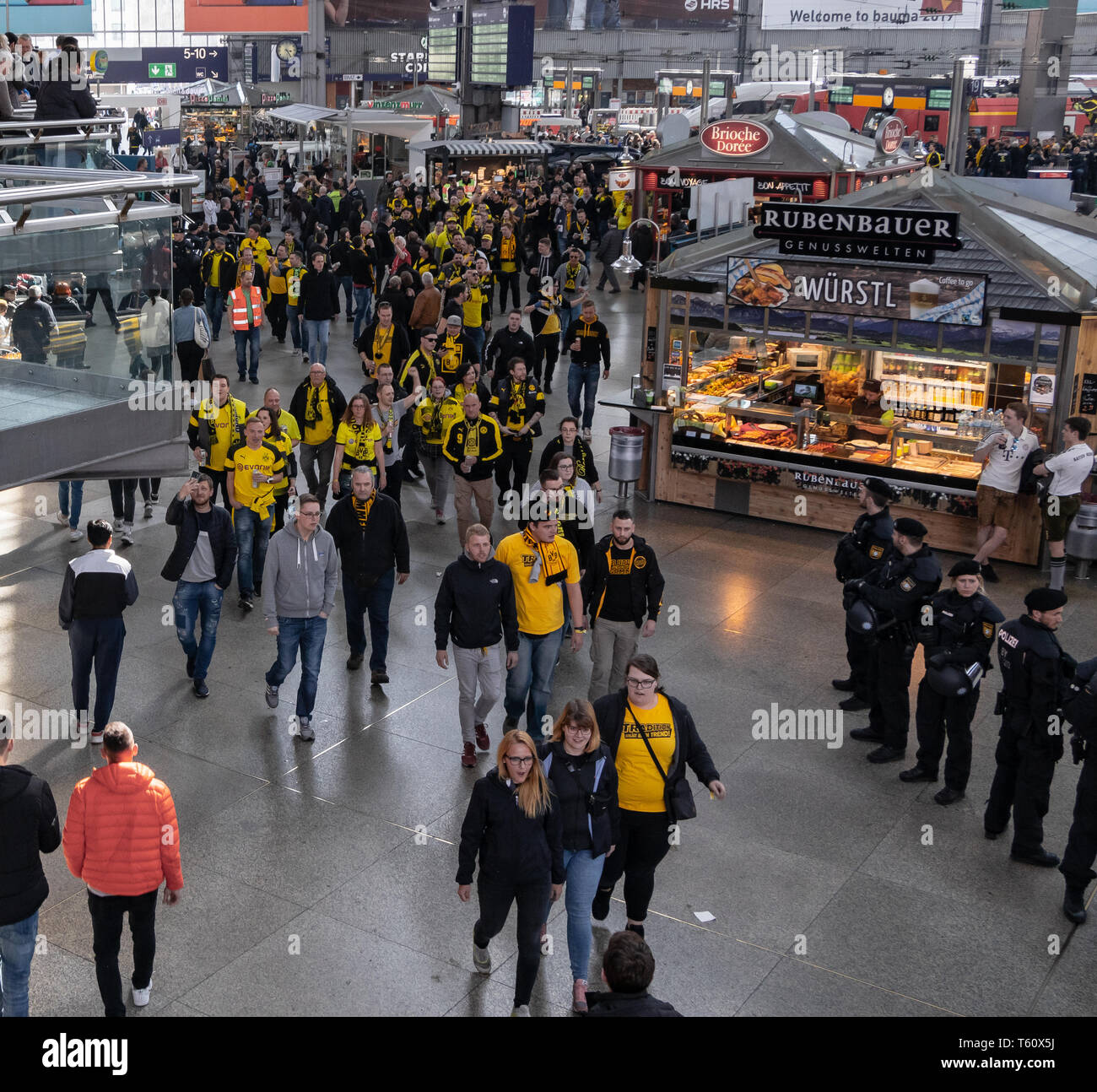CENTRAL STATIONS, MUNICH, APRIL 6, 2019: bvb fans on the way to the soccer game fc bayern munich vs bvb Stock Photo