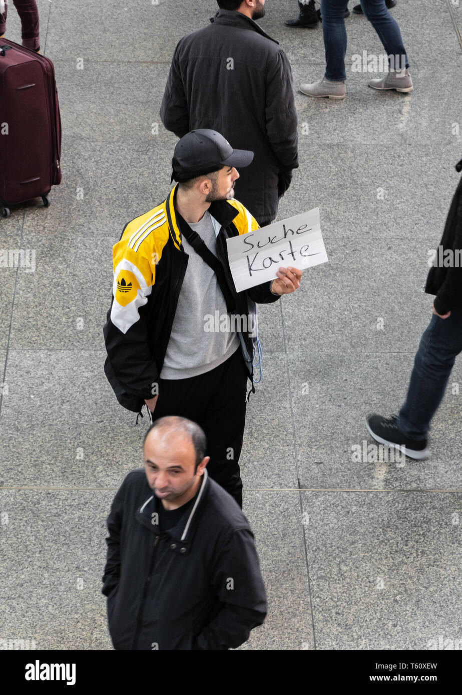 CENTRAL STATIONS, MUNICH, APRIL 6, 2019: borussia dortmund fan looking for tickets for a soccer game. Stock Photo
