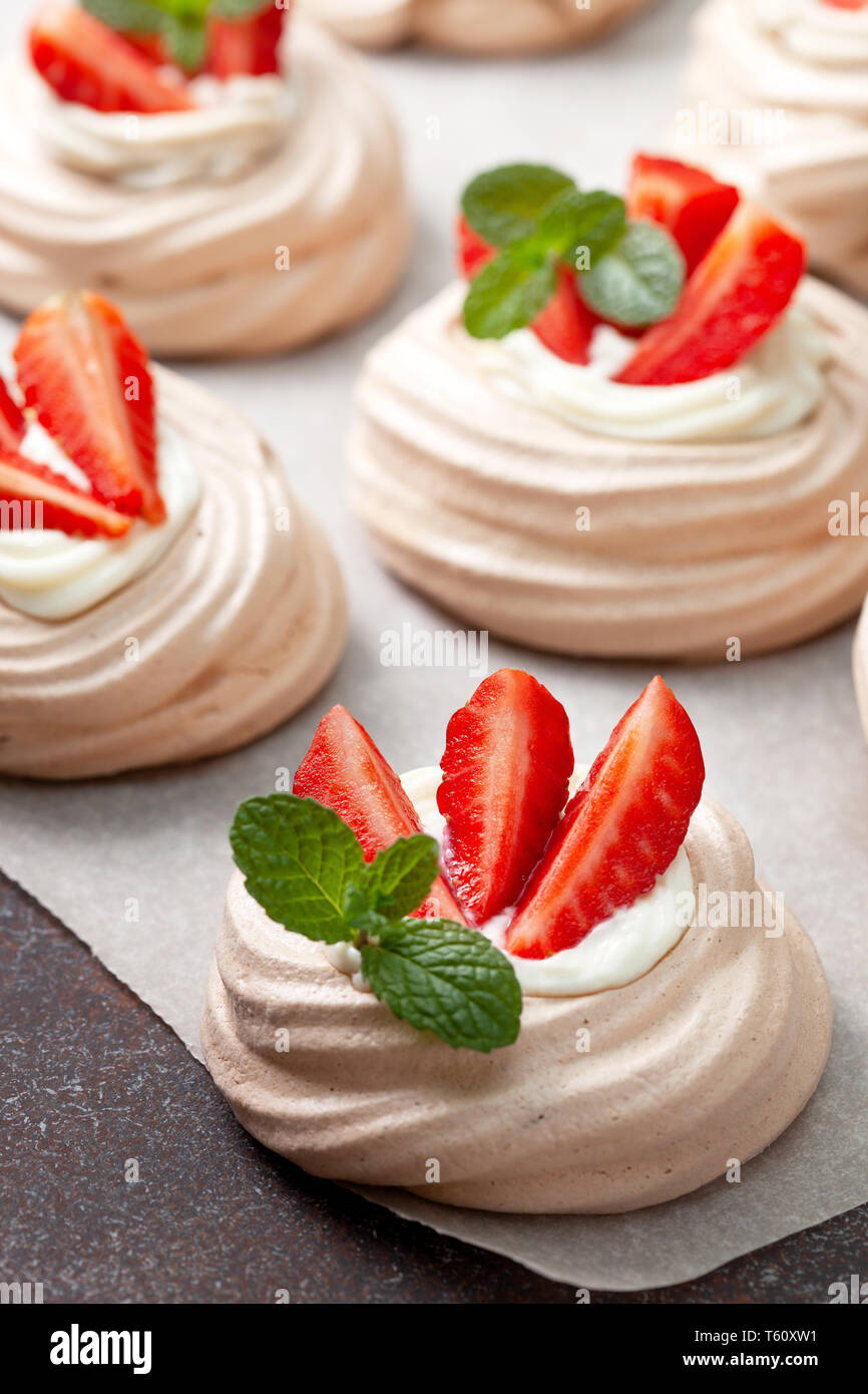 pavlova chocolate mini cakes with strawberries close-up Stock Photo