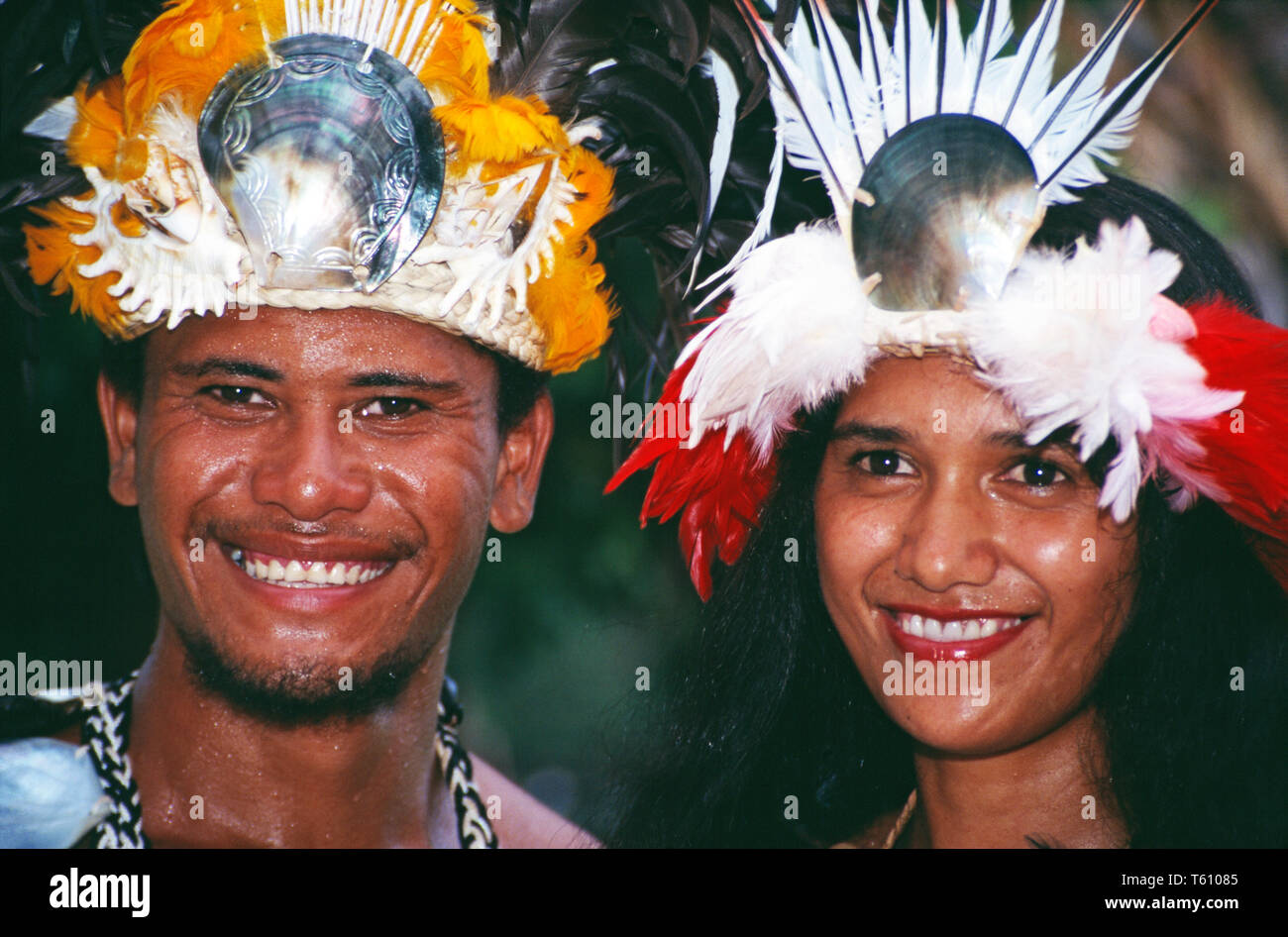 French Polynesia. Society Islands. Tahiti. Outdoor portrait  of Tahitian man and woman in traditional wedding costume. - Stock Image